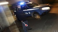 An Italian police car leaves a police station in Pianopoli village, near Catanzaro, Italy on 7 May 2015.