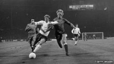 English footballer Colin Bell beats Poland's Jerzy Gorgon in 1973 match