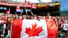 Fans cheer for Team Canada as they take on Team China during a FIFA Women's World Cup soccer match in Edmonton, Alberta, on Saturday June 6, 2015. (Jason Franson/The Canadian Press via AP) MANDATORY CREDIT