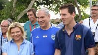 Prime Minister Benjamin Netanyahu and his wife, Sara, walk alongside FC Barcelona superstar Lionel Messi, Sunday, August 4, 2013 (photo credit: Avi Ohayon/GPO/Flash90)