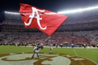 Sep 13, 2014; Tuscaloosa, AL, USA; Alabama Crimson Tide mascot Big Al waves the Alabama flag following their 52-12 victory against the Southern Miss G...