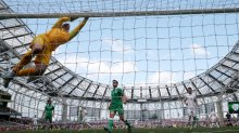 Some action: England goalkeeper Joe Hart swings on the crossbar.