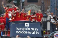 Spain's national soccer team players celebrate their Euro 2012 victory on an open top bus during a parade in downtown Madrid July 2, 2012. Spaniards seized on their Euro 2012 triumph as a source of restored national pride after months of economic anxieties, as celebrations were set to reach fever pitch on Monday with a victory parade in the capital. REUTERS-Andrea Comas